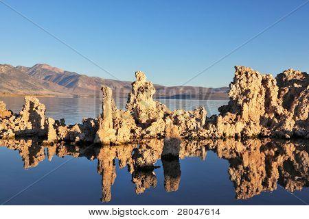 Fantastically beautiful landscape. Mono Lake at sunset. Lake Tufa stalagmites reflected in the smooth waters of lake