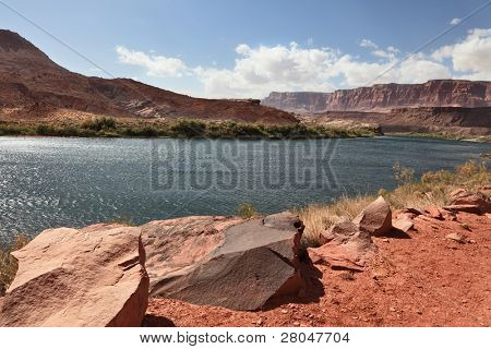 A reservation of Indians of the Navajo, the USA. Magnificent cold water the river Colorado in abrupt coast from red sandstone