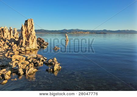 Mono Lake stalagmites of the Tufa. Fantastically beautiful landscape. Mono Lake at sunset.