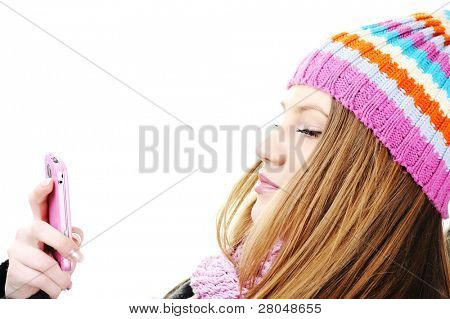 Winter Beautiful Girl reading sms message on cell phone