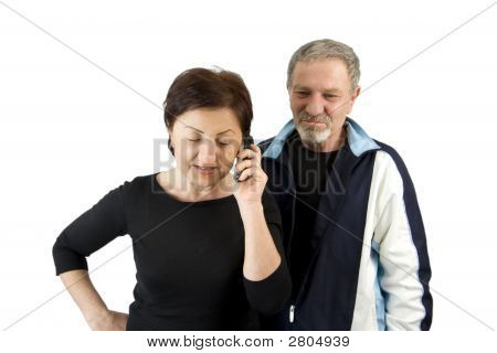 Wife On The Phone While Husband Waiting For The News