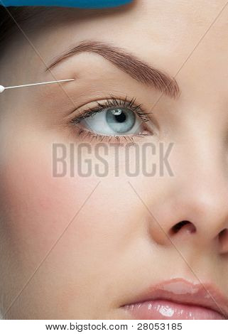 Cosmetic injection of to the pretty female face. Isolated on white background