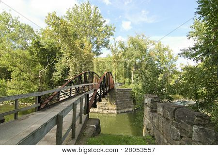 canal and wooden walking bridge