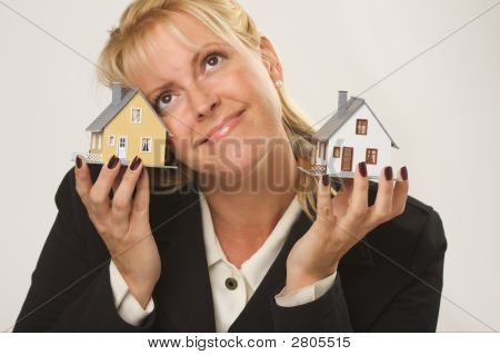 Two Houses In Female Hands