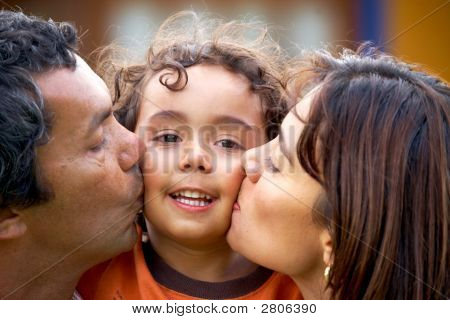 Parents Kissing Their Son