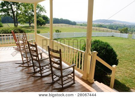 historic house and porch rocking chairs