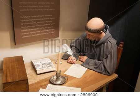 visitor center statue of a friar writing