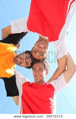 Sports team with heads together
