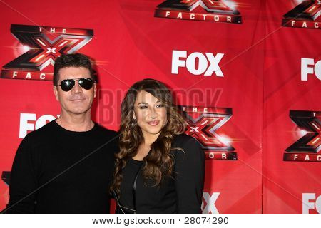 """LOS ANGELES - DEC 19:  Simon Cowell, Melanie Amaro at the FOX's """"The X Factor"""" Press Conference  at CBS Studios on December 19, 2011 in Los Angeles, CA"""