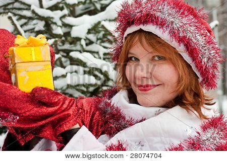 woman dressed like santa claus with gift in hand