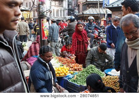KATHMANDU, NEPAL - JANUARY 1 : Local people on the street sell local vegetable on January 1, 2009 in Kathmandu. The basic branch of economy in Nepal - agriculture (76 % of working population).