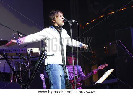 "TOMSK, RUSSIA - FEBRUARY 23: Ilya Lagutenko - russian singer, frontman of pop-rock group ""Mumiy Troll"" in a night club ""Teatro"", February 23, 2009 in Tomsk, Russia."