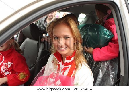TOMSK, RUSSIA - AUGUST 28:  Margarita Aliychuk -gymnast, Olympic Champion 2008, in given a present it by the governor of the Tomsk area Victor Kress, car Toyota Rav4, August 28, 2008 in Tomsk, Russia.