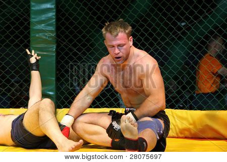 TOMSK, RUSSIA - JULY 2: Fight in championship of Russia of mixed fighting single combats, July 2, 2009 in Tomsk, Russia.