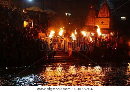 HARIDWAR, INDIA - JANUARY 14: Night puja ceremony on the banks of Ganga river. People celebrate Kumbh Mela, huge Religious festival regarding Sun and Harvest, January 14, 2009 in Haridwar, India.