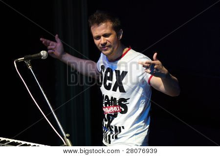 "TOMSK, RUSSIA - JUNE 6: Maxim Postelniy - frontman of disco group ""Plazma"" performing in a night club ""Teatro"", June 6, 2009 in Tomsk, Russia."