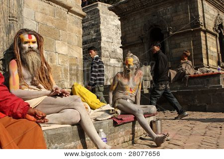 KATHMANDU, NEPAL - JANUARY 2: Sadhu (holy man) seeking alms in front of at Pashupatinath Temple on the banks of River Baghmati, January 2, 2009 in Kathmandu, Nepal.