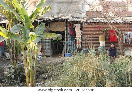 KATHMANDU, NEPAL - JANUARY 7: A generic view of a poor housing area at Old Baneshwor near Bagmati river January 7, 2009 in Kathmandu Nepal.