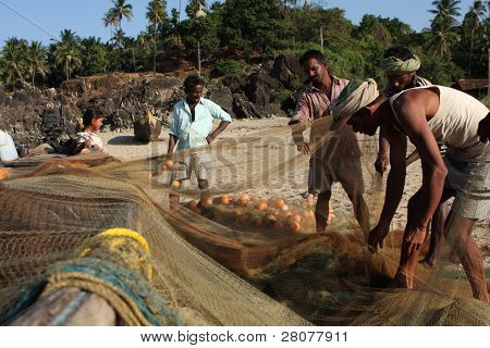 GOKARNA, INDIA - DECEMBER 14: Fishermen from Indian state Karnataka, prepare gear for fishing in the Indian ocean, December 14, 2008 in Gokarna, India.