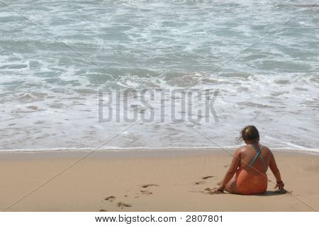 Little Girl Playing In The Beach