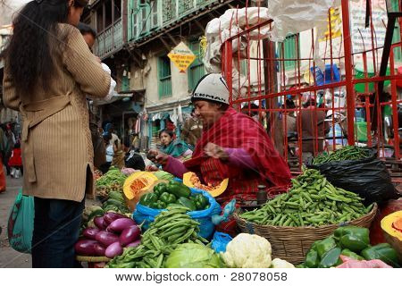 KATHMANDU, NEPAL - DECEMBER 29 : Local people on the street sell local vegetable. The basic branch of economy in Nepal - agriculture (76 % of working population), December 29, 2008 in Kathmandu, Nepal