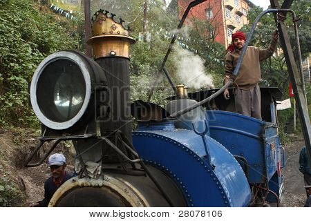 "DARJEELING, INDIA - DECEMBER 3: The Darjeeling Himalayan Railway, nicknamed the ""Toy Train"", is a 2 ft (610 mm) narrow-gauge railway from Siliguri to Darjeeling, December 3, 2008 in Darjeeling, India."