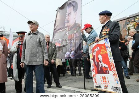 MOSCOW - MAY 1: Communist party supporters take part in a rally marking the May Day, a portrait of Soviet dictator Josef Stalin seen in the background, May 1, 2010 in Moscow, Russia.