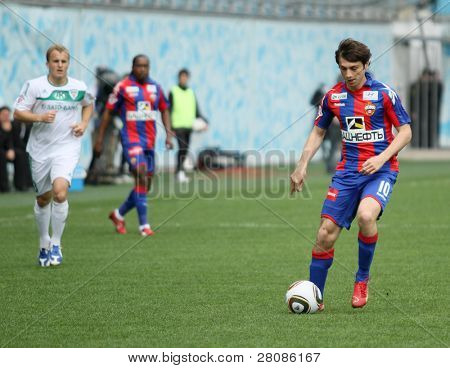 MOSCOW - MAY 10: CSKAs Alan Dzagoev (R) in action during their teams Russian football championship game CSKA (Moscow) vs. Terek (Grozny) - (4:1), May 10, 2010 in Moscow, Russia.