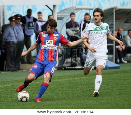 MOSCOW - MAY 10: CSKAs Alan Dzagoev (L) in action during their teams Russian football championship game CSKA (Moscow) vs. Terek (Grozny) - (4:1), May 10, 2010 in Moscow, Russia.