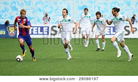 MOSCOW - MAY 10: CSKAs Keisuke Honda (L) in action during their teams Russian football championship game CSKA (Moscow) vs. Terek (Grozny) - (4:1), May 10, 2010 in Moscow, Russia.