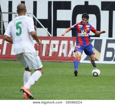 MOSCOW - MAY 10: CSKAs Mark Gonzalez (R) in action during their teams Russian football championship game CSKA (Moscow) vs. Terek (Grozny) - (4:1), May 10, 2010 in Moscow, Russia.