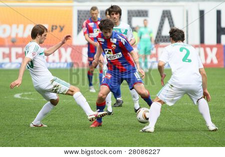 MOSCOW - MAY 10: CSKAs Alan Dzagoev (C) in action during their teams Russian football championship game CSKA (Moscow) vs. Terek (Grozny) - (4:1), May 10, 2010 in Moscow, Russia.