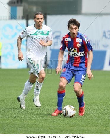 MOSCOW - MAY 10: CSKA's Alan Dzagoev (R) in action during their team's Russian football championship game CSKA (Moscow) vs. Terek (Grozny) - (4:1), May 10, 2010 in Moscow, Russia.