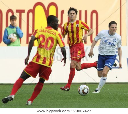 MOSCOW - MAY 15: Alania's midfielder George Floresku (C) and Alania's midfielder Dakosta Akes Gur (L) in a game Dinamo Moscow vs. Alania Vladikavkaz - 2:0, May 15, 2010 in Moscow, Russia.