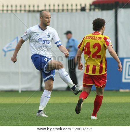 MOSCOW - MAY 15: Dinamo's midfielder Dmitry Hohlov (L) and Alania's midfielder Jury Kirillov (R) in a game Dinamo Moscow vs. Alania Vladikavkaz - 2:0, May 15, 2010 in Moscow, Russia.