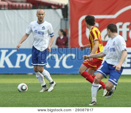 MOSCOW - MAY 15: Dinamo's midfielder Dmitry Hohlov (L) in a game of the 11th round of Russian Football Premier League - Dinamo Moscow vs. Alania Vladikavkaz - 2:0, May 15, 2010 in Moscow, Russia.