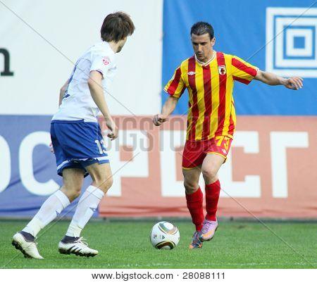 MOSCOW - MAY 15: Dinamo's defender Vladimir Granat (R) and Alania's midfielder Ivan Stojanov (R) in a game Dinamo Moscow vs. Alania Vladikavkaz - 2:0, May 15, 2010 in Moscow, Russia.