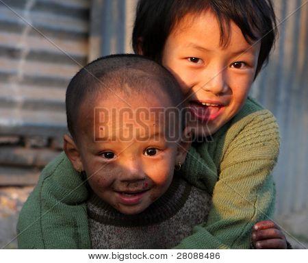 KATHMANDU, NEPAL - JANUARY 7: children  Di Lakshmi (back) and Vishnu Kumar of a poor area at Old Baneshwor near Bagmati river, January 7, 2009 in Kathmandu Nepal.