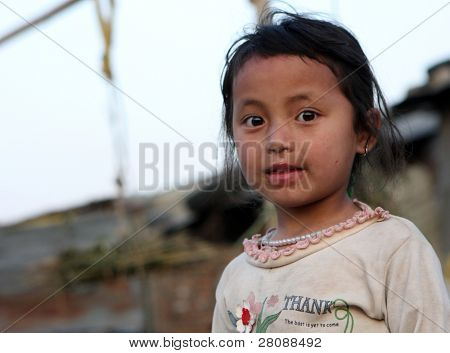 KATHMANDU, NEPAL - JANUARY 7: Prithivi Rudra - girl of a poor area at Old Baneshwor near Bagmati river, January 7, 2009 in Kathmandu Nepal.