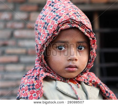 KATHMANDU, NEPAL - JANUARY 7: Tara Kumar - boy with a sorrowful eyes in Kathmandu with a population of around 800,000 is the largest city in the country, January 7, 2009 in Kathmandu Nepal.