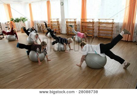 PODPOROZHYE, RUSSIA - JUNE 4: Day of Health in Center of social services for pensioners and the disabled Otrada (gymnastics with ball for elders), June 4, 2010 in Podporozhye, Russia.