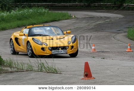 DMITROV, RUSSIA - JUNE 13: A unidentified participant in Lotus Exige in the first Championship 'Rus Hill climb Open' at avtopoligone NIITSAMT, June 13, 2010 in Dmitrov, Russia.
