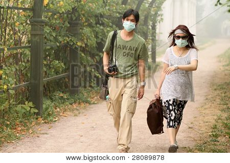 MOSCOW - AUGUST 7: foreign tourists in a gas mask to protect the lungs from the high concentration of carbon monoxide caused by smoke from the forest fires, August 7, 2010 in Moscow, Russia.