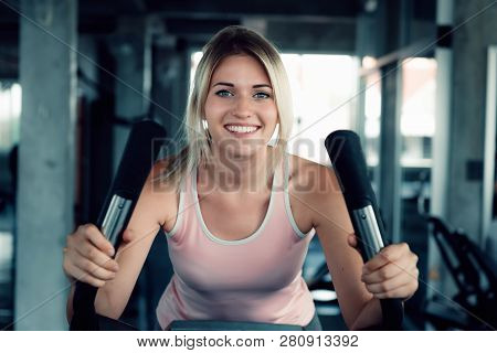 poster of Woman Workout Cycling Exercise In Fitness Gym., Portrait Of Pretty Attractive Caucasian Woman Cyclin