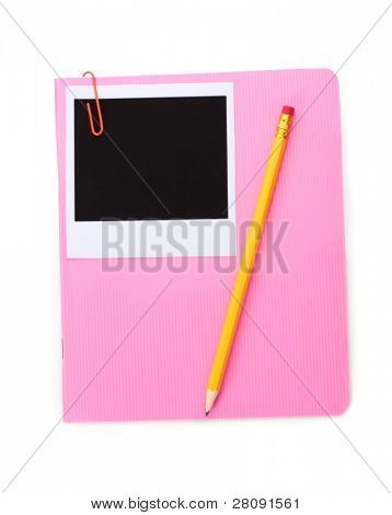 Photo paper and pink notebook isolated on white