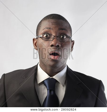 African businessman with astonished expression
