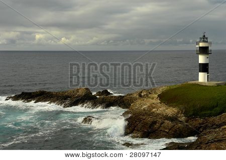 small lighthouse at the coast of north of spain