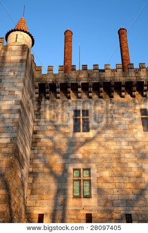 Detail of the facade of Paco dos Duques de Braganca in Guimaraes, Portugal first capital city