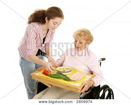Teen Volunteer With Senior