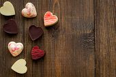 Heart-shaped Confection For Valentines Day On Dark Wooden Background Top View Space For Text poster